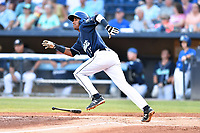 Asheville Tourists Cristopher Navarro (11) runs to first base during a game against the Charleston RiverDogs at McCormick Field on August 15, 2019 in Asheville, North Carolina. The Tourists defeated the RiverDogs 6-3. (Tony Farlow/Four Seam Images)