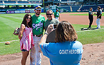 HARTFORD,  CT-071818JS22--Hartford's Brendan Rodgers (1) gets his photo taken with Ann Furstace and Ralph Nenna, both of Orlando, Florida prior to the Yard Goat's game against Reading on Wednesday afternoon at Dunkin Donuts Park in Hartford. Nenna was Rodgers coach when he played travel baseball in Florida as a kid.<br /> Jim Shannon Republican American