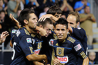 Jack McInerney (19) of the Philadelphia Union celebrates scoring with teammates. The Philadelphia Union and the Houston Dynamo played to a 1-1 tie during a Major League Soccer (MLS) match at PPL Park in Chester, PA, on August 6, 2011.