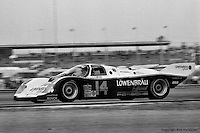 DAYTONA BEACH, FL: The Holbert Racing Porsche 962 103 of Al Unser, Jr., Derek Bell and Al Holbert on the infield road course during the 24 Hours of Daytona on February 3, 1985, at the Daytona International Speedway. (Photo by Bob Harmeyer)