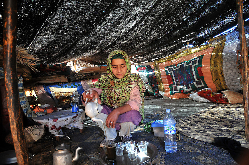 Nomad woman preparing tea under the tent