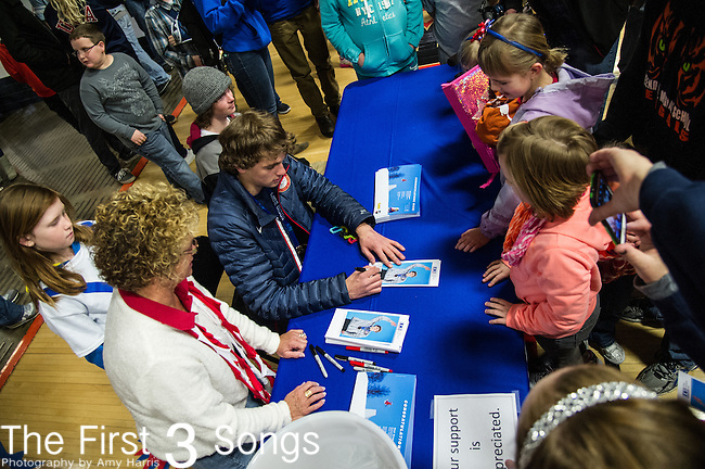 Olympic slopestyle bronze medalist Nick Goepper signs autographs during a parade and celebration in his honor in Lawrenceburg, Indiana.