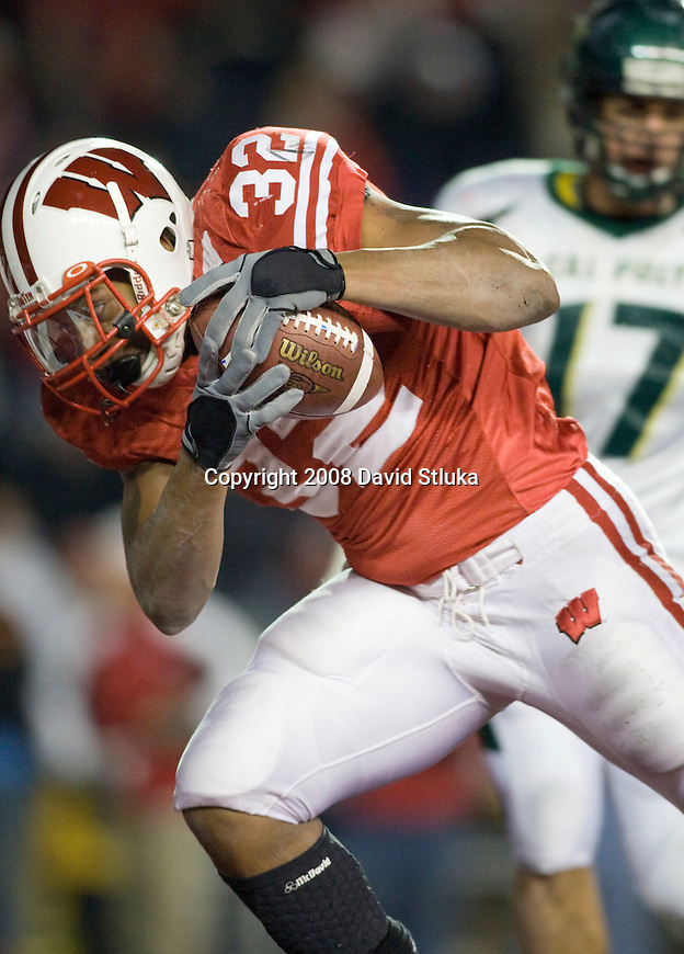 MADISON, WI - NOVEMBER 22: Running back John Clay #32 of the Wisconsin Badgers scores a touchdown in overtime against the Cal Poly Mustangs at Camp Randall Stadium on November 22, 2008 in Madison, Wisconsin. Wisconsin beat Cal Poly 36-35 in overtime. (Photo by David Stluka)