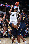 Devin Thomas (2) of the Wake Forest Demon Deacons draws a blocking foul on Chris Jones (12) of the Pittsburgh Panthers during second half action at the LJVM Coliseum on March 1, 2015 in Winston-Salem, North Carolina.  The Demon Deacons defeated the Panthers 69-66.  (Brian Westerholt/Sports On Film)