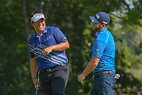 Kiradech Aphibarnrat (THA) celebrates with Andy Sullivan (ENG) after Sullivan's long chip in on 9 during 2nd round of the 100th PGA Championship at Bellerive Country Club, St. Louis, Missouri. 8/11/2018.<br /> Picture: Golffile | Ken Murray<br /> <br /> All photo usage must carry mandatory copyright credit (© Golffile | Ken Murray)