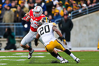 Ohio State Buckeyes tight end Jeff Heuerman (86) charges down the field as Iowa Hawkeyes linebacker Christian Kirksey (20) tries to stop him during Saturday's game in Columbus, Ohio on Saturday, Oct. 19, 2013. (Jabin Botsford / The Columbus Dispatch)