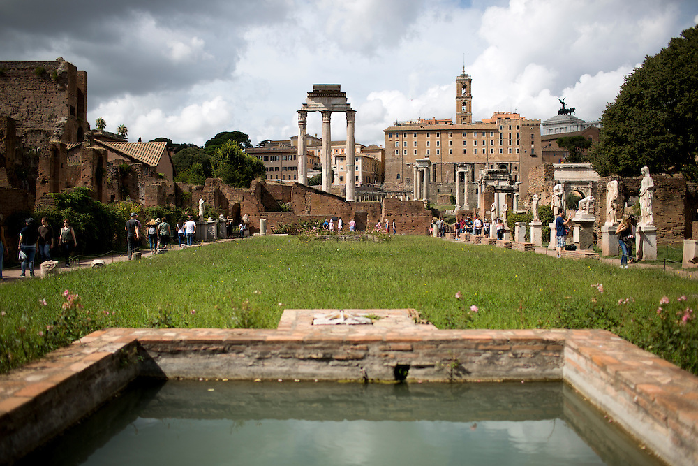 Tourists walk through the ruins of the House of the Vestals in the Roman Forum on Wednesday, Sept. 23, 2015, in Rome, Italy. (Photo by James Brosher)