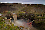 Washington, Southeast, Palouse Falls during high flow drops 198 ft. over basalt cliffs into Palouse Canyon before its muddy waters join the Snake River just downstream.