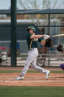 Oakland Athletics second baseman Jordan Tarsovich (7) follows through on his swing during a Minor League Spring Training game against the Chicago Cubs at Sloan Park on March 13, 2018 in Mesa, Arizona. (Zachary Lucy/Four Seam Images)
