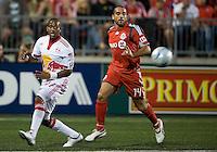 13 June2009:New York Red Bulls defender Jeremy Hall #17 and Toronto FC midfielder Dewayne DeRosario #14 in action during MLS action at BMO Field in Toronto, in a game between the New York Red Bulls and Toronto FC. Toronto FC won 2-1..