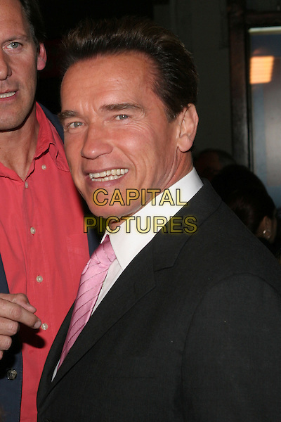 "ARNOLD SCHWARZENEGGER.""The Kid & I"" Los Angeles Premiere - Arrivals held at Grauman's Chinese Theatre.  Hollywood, California..USA, United States..28th November 2005.Ref:ADM/ZL.portrait headshot pink silk satin tie suit jacket smiling.www.capitalpictures.com.sales@capitalpictures.com.© Capital Pictures."