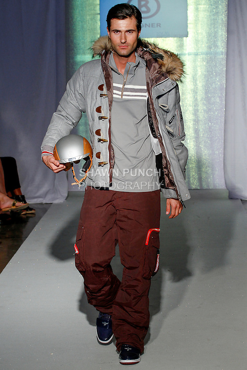 Model walks runway in an outfit from the Bogner collection, during the SNOW Fashion NYC - Ski fashion show, June 11, 2013.