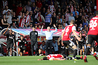 Brentford Manager, Dean Smith and the home fans react after a challenge from Sam Morsy of Wigan on Brentford's Yoann Barbet  during Brentford vs Wigan Athletic, Sky Bet EFL Championship Football at Griffin Park on 15th September 2018