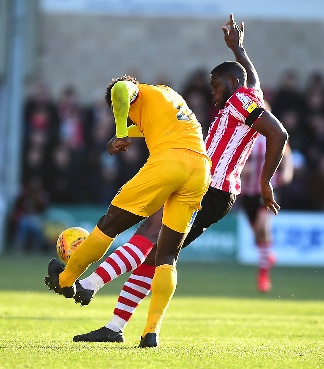 Lincoln City's John Akinde battles with  Northampton Town's Aaron Pierre<br /> <br /> Photographer Andrew Vaughan/CameraSport<br /> <br /> The EFL Sky Bet League Two - Lincoln City v Northampton Town - Saturday 9th February 2019 - Sincil Bank - Lincoln<br /> <br /> World Copyright &copy; 2019 CameraSport. All rights reserved. 43 Linden Ave. Countesthorpe. Leicester. England. LE8 5PG - Tel: +44 (0) 116 277 4147 - admin@camerasport.com - www.camerasport.com