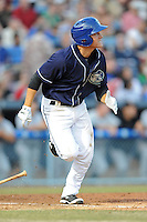 Asheville Tourists shortstop Pat Valaika #16 runs to first during opening night game against the Delmarva Shorebirds at McCormick Field on April 3, 2014 in Asheville, North Carolina. The Tourists defeated the Shorebirds 8-3. (Tony Farlow/Four Seam Images)