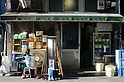 Tokyo, Japan - Tofu shop. Yutaka Takayanagi (65) is working as a Tofu maker. He makes approximately 600 pieces of tofu everyday. Tofu is an Asian food made from soy milk.<br /> <br /> He runs Takayanagi Tofu shop in Chuo-ku, Tokyo with his family. He has a wife and two children. His son is also a Tofu maker and managing their shop as well.<br /> <br /> He started his career when he was a student back 45 years ago because of the staff shortage; he had helped out his family. First of all, what he managed was delivering Tofu by a bicycle. He began making Tofu following his father's examples and he says, &quot;I sold so many Tofu, which were not really perfect haha, but now I am very satisfied of what I make&quot;. He considers Tofu's hardness is very important; changing it depends on his customer's usages. (Ex, Fried Tofu should be harder than Tofu to be eaten raw.)<br /> <br /> He usually wakes up around 5 AM and starts working as soon as he gets up. It takes an hour to make Tofu after the processes such as compression, boiling and crushing beans, and more progresses. Their clients are mainly restaurants, cafeterias of institutions, schools, residents of the area and so on. Their main sales are provided by delivery services.<br /> <br /> These days, Tofu sweets are getting very popular and popular, such as Tofu ice cream, yoghurt, pudding, and etc,. He thinks those are tasty and interesting, but he is not trying to expand his business rather than making Tofu as this traditional way.<br /> <br /> While the shop is open, friendly customers come to buy their hand-made Tofu, which is not much around Tokyo area due to the machinery manufacturing. On the other hand, Takayanagi Tofu shop keeps their recipe of making handmade Tofu for more than 80 years. For the next generation, his son is going to take over the Tofu master's position. However, Yutaka says, &quot;My son still needs to work on more and more!&quot;