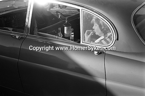 Gordons Gin and tonic in the back of the Jaguar car. The Derby Horse race Epsom Down. Surrey England 1970.<br />