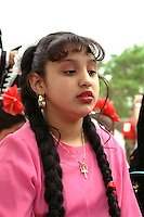 Mexican American woman age 16 participating in Cinco de Mayo parade.  St Paul Minnesota USA