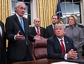 United States President Donald J. Trump listens as US Senator Ed Markey (Democrat of Massachusetts), a sponsor of the bill, makes remarks prior to his signing the bipartisan Interdict Act, a bill to stop the flow of opioids into the United States in the Oval Office of the White House in Washington, DC on Wednesday, January 10, 2018.  The Interdict Act will provide Customs and Border Protection agents with the latest screening technology devices used to secure our border from illicit materials, specifically fentanyl, a powerful opioid that is destroying lives across the country. <br /> Credit: Ron Sachs / Pool via CNP