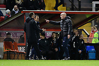Fourth official Joe Clark, left, speaks to Port Vale manager Neil Aspin<br /> <br /> Photographer Chris Vaughan/CameraSport<br /> <br /> The EFL Sky Bet League Two - Lincoln City v Port Vale - Tuesday 1st January 2019 - Sincil Bank - Lincoln<br /> <br /> World Copyright © 2019 CameraSport. All rights reserved. 43 Linden Ave. Countesthorpe. Leicester. England. LE8 5PG - Tel: +44 (0) 116 277 4147 - admin@camerasport.com - www.camerasport.com