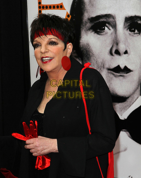 Liza Minnelli.2012 TCM Classic Film Festival Opening Night Gala Held at Grauman's Chinese Theatre, Hollywood, California, USA..April 12th, 2012.half length black red circle disc earrings headband lipstick jacket holding carrying gloves .CAP/ADM/KB.©Kevan Brooks/AdMedia/Capital Pictures.