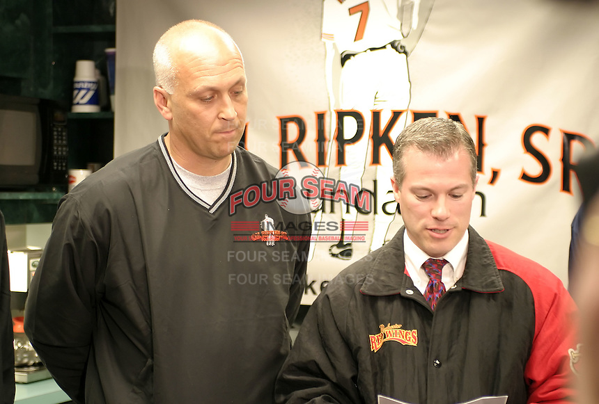 April 13, 2004:  Hall of Fame shortstop Cal Ripken and General Manager Dan Mason during an appearance with the Rochester Red Wings, Triple-A International League affiliate of the Minnesota Twins, before a game at Frontier Field in Rochester, NY.  Photo by:  Mike Janes/Four Seam Images
