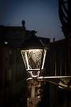 Streetlight cobweb, Girona, Catalonia, Spain