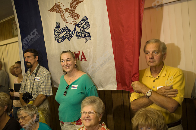 Supporters of former Senator John Edwards (D-North Carolina), potential Democratic presidential candidate, listen as he campaigns at the UAW Local 74 in Ottumwa. Ottumwa, Iowa, August 16, 2007.