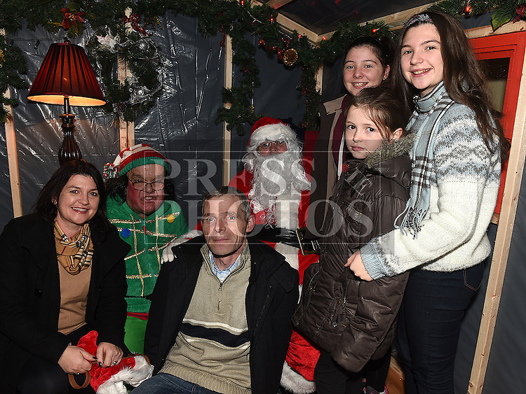 Rachel, Sarah and Ellie Byrne from Drumconrath with parents Pat and Breda pictured with Santa and Bubbles in Ardee Castle. Photo:Colin Bell/pressphotos.ie