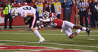 10/31/15<br /> Arkansas Democrat-Gazette/STEPHEN B. THORNTON<br /> Ut Martin's Ben Axline crosses the goal line for his team's final TD in the fourth quarter as he is defended by Arkansas' Willie Sykes, right, during their game Saturday in Fayetteville.