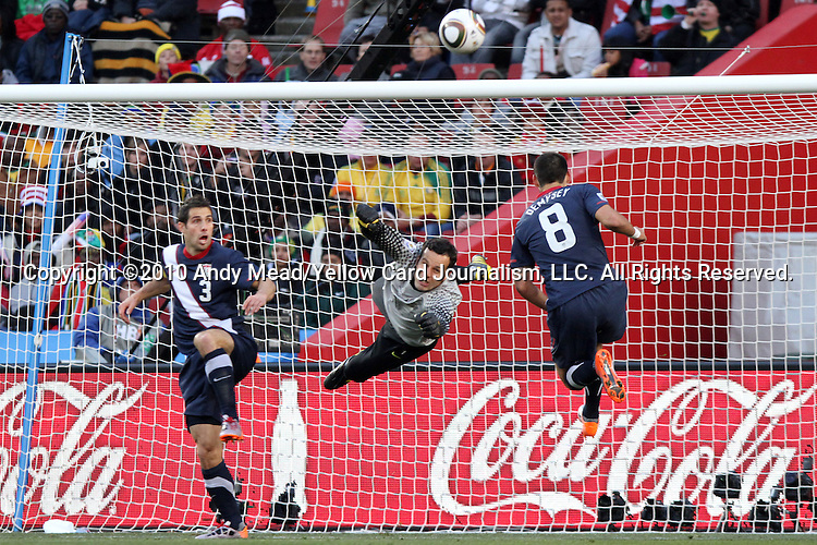 18 JUN 2010: Samir Handanovic (SVN) (center) punches a ball away from Clint Dempsey (USA) (8). The Slovenia National Team tied the United States National Team 2-2 at Ellis Park Stadium in Johannesburg, South Africa in a 2010 FIFA World Cup Group C match.