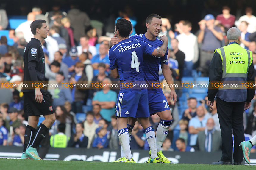 Cesc Fabregas of Chelsea celebrates at the final whistle with John Terry - Chelsea vs Arsenal - Barclays Premier League Football at Stamford Bridge, London - 05/10/14 - MANDATORY CREDIT: Paul Dennis/TGSPHOTO - Self billing applies where appropriate - contact@tgsphoto.co.uk - NO UNPAID USE