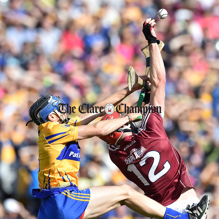 David Mc Inerney of Clare in action against Jonathan Glynn of Galway during their All-Ireland semi-final at Croke Park. Photograph by John Kelly.