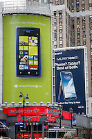 Advertising for Microsoft Windows 8 operating software in front of a billboard for the Samsung Note II mobile phone using Google's Android operating software in midtown Manhattan in New York on Friday, January 25, 2013.  (© Richard B. Levine)