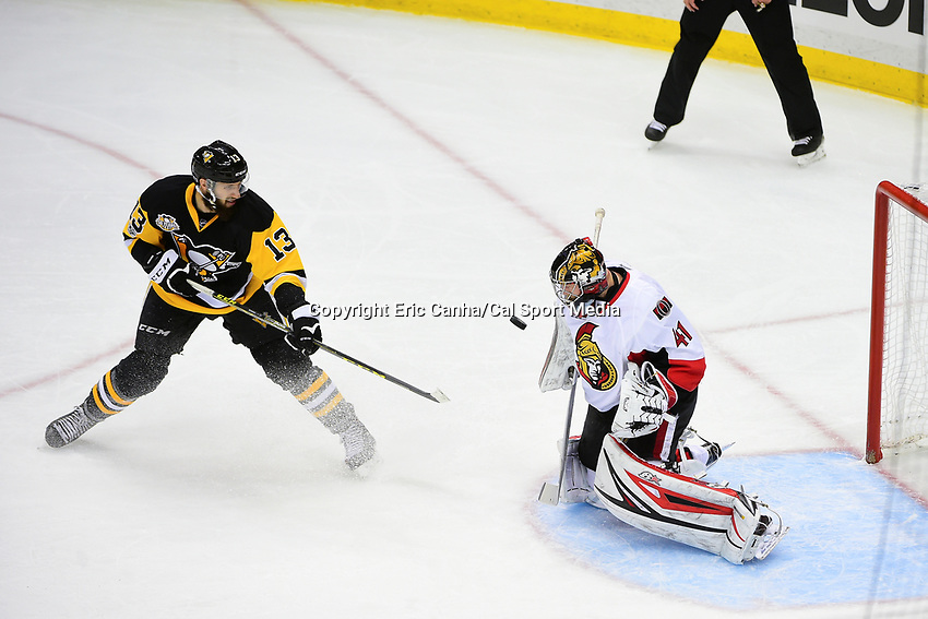 May 15, 2017: Pittsburgh Penguins center Nick Bonino (13) shoots on Ottawa Senators goalie Craig Anderson (41) during game two of the National Hockey League Eastern Conference Finals between the Ottawa Senators and the Pittsburgh Penguins, held at PPG Paints Arena, in Pittsburgh, PA. Pittsburgh defeats Ottawa 1-0 in regulation to tie the series 1-1. Eric Canha/CSM