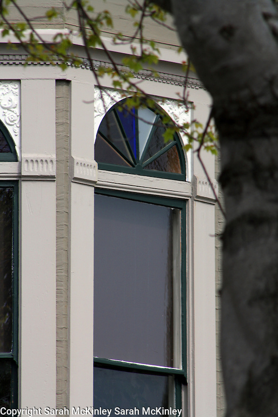A stained glass fanlight window in Old Town Eureka in Humboldt County in Northern California.