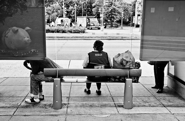 Commuters wait for the bus at the corner of 7th and Pennsylvania Ave. SE near Eastern Market on June 7, 2010.