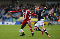 Brentford's Romaine Sawyers shields the ball from Millwall's George Saville during Millwall vs Brentford, Sky Bet EFL Championship Football at The Den on 10th March 2018
