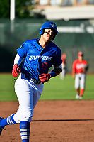 Romer Cuadrado (17) of the Ogden Raptors rounds the bases against the Orem Owlz in Pioneer League  action at Lindquist Field on June 22, 2017 in Ogden, Utah. The Owlz defeated the Raptors 13-8.  (Stephen Smith/Four Seam Images)