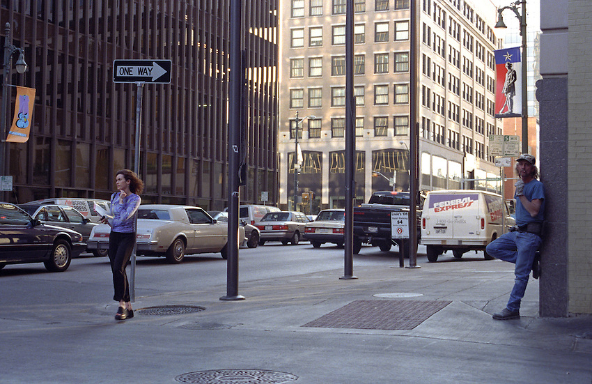 Laconic man, winsome woman, East 6th Street at Congress Avenue, downtown Austin Texas, USA