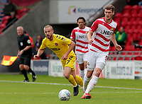 Fleetwood Town's Paddy Madden chases down Doncaster Rovers' Joe Wright<br /> <br /> Photographer David Shipman/CameraSport<br /> <br /> The EFL Sky Bet League One - Doncaster Rovers v Fleetwood Town - Saturday 6th October 2018 - Keepmoat Stadium - Doncaster<br /> <br /> World Copyright &copy; 2018 CameraSport. All rights reserved. 43 Linden Ave. Countesthorpe. Leicester. England. LE8 5PG - Tel: +44 (0) 116 277 4147 - admin@camerasport.com - www.camerasport.com