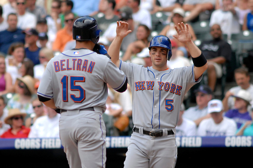22 June 2008: New York Mets 3rd baseman David Wright congratulates teammate Carlos Beltran after Beltran hit a two-run homerun against the Colorado Rockies. The Mets defeated the Rockies 3-1 at Coors Field in Denver, Colorado on June 22, 2008. FOR EDITORIAL USE ONLY. FOR EDITORIAL USE ONLY
