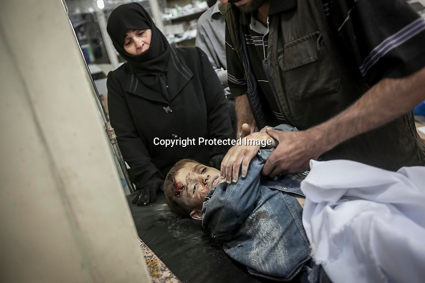 In this Thursday, Nov. 01, 2012 photo, a Syrian woman mourns the lifeless body of her son at one hospital after arrives dead by a mortar shell explosion when it landed in the nearby civilian neighborhood of Tarik Al-Bab in Aleppo, the Syrian's largest city. (AP Photo/Narciso Contreras).