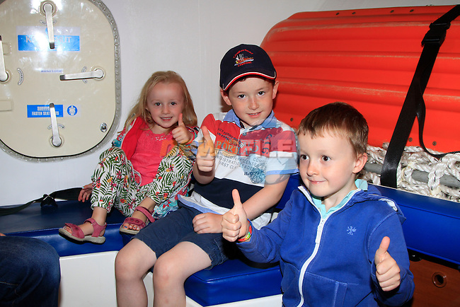 Aoivheann Maree, Rhys Shevlin and Ciaran Maree in the recovery room on board &quot;Doris&quot; during the Clogherhead RNLI Lifeboat Open Day on Saturday 16th August 2014.<br /> Picture:  Thos Caffrey / www.newsfile.ie