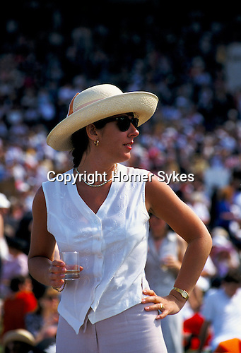 WOMAN WEARING LARGE STRAW HAT, ASCOT RACES,