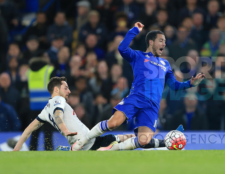 Chelsea's Eden Hazard gets fouled by Tottenham's Ryan Mason during the Barclays Premier League match at Stamford Bridge Stadium.  Photo credit should read: David Klein/Sportimage