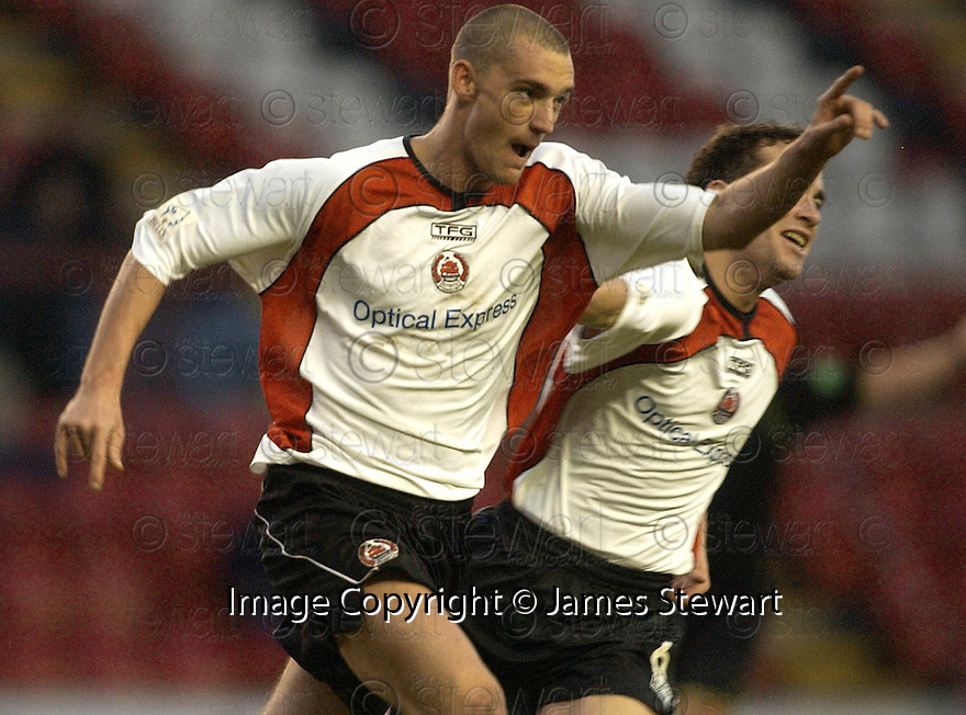 14/01/2006         Copyright Pic: James Stewart.File Name : sct_jspa06_clyde_v_stjohnstone.THOMAS BRIGHTON CELEBRATES AFTER HE SCORES CLYDE'S SECOND TO SET UP AN EXCITING FINISH.......Payments to :.James Stewart Photo Agency 19 Carronlea Drive, Falkirk. FK2 8DN      Vat Reg No. 607 6932 25.Office     : +44 (0)1324 570906     .Mobile   : +44 (0)7721 416997.Fax         : +44 (0)1324 570906.E-mail  :  jim@jspa.co.uk.If you require further information then contact Jim Stewart on any of the numbers above.........