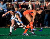 Teryn Brill (1) of UNC tries to block the shot of Paige Selenski (21) of Virginia during the NCAA Field Hockey Championship semfinals in College Park, MD.  North Carolina defeated Virginia, 4-3, in overtime.