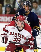 Loren Barron (Quinnipiac - 4), Conor Morrison (Harvard - 38) - The Harvard University Crimson and Quinnipiac University Bobcats played to a 2-2 tie on Saturday, November 5, 2011, at Bright Hockey Center in Cambridge, Massachusetts.