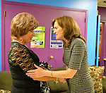 Bellmore, New York, USA. September 16, 2014. KATHLEEN RICE, Democratic congressional candidate (NY-04), speaks with BARBARA SALVA, of LITAC, Long Island Transgender Advocacy Coalition. Rice, joined by local LGBT actvitists, called for congressional action both to pass legislation prohibiting employment discrimination on basis of sexual orientation and gender identity, and to fully repeal the Defense of Marriage Act. Rice first toured Pride For Youth, a program that provides services for lesbian, gay, bisexual and transgender youth and their families, and a division of the Long Island Crisis Center.